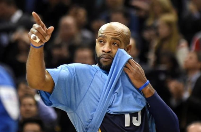 Nov 19, 2014; Toronto, Ontario, CAN; Memphis Grizzlies forward Vince Carter gestures as he reacts to a highlight reel from his days in Toronto as the Raptors paid tribute to him as part of their 20th anniversary celebrations in the first quarter at Air Canada Centre. Mandatory Credit: Dan Hamilton-USA TODAY Sports