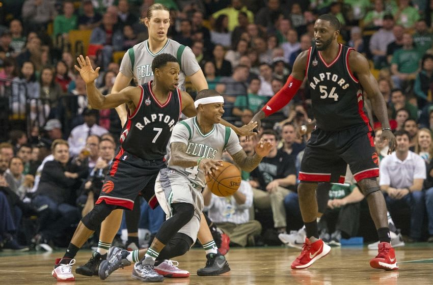 Oct 30, 2015; Boston, MA, USA; Boston Celtics point guard Isaiah Thomas (4) dribbles the ball around the key with Toronto Raptors point guard Kyle Lowry (7) and Toronto Raptors power forward Patrick Patterson (54) defending during the 2nd quarter at TD Garden. Mandatory Credit: Gregory J. Fisher-USA TODAY Sports