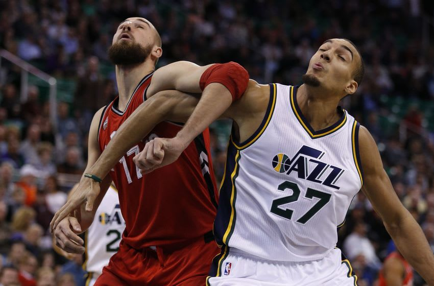Nov 18, 2015; Salt Lake City, UT, USA; Toronto Raptors center Jonas Valanciunas (17) and Utah Jazz center Rudy Gobert (27) battle for position under the basket in the first quarter at EnergySolutions Arena. Mandatory Credit: Jeff Swinger-USA TODAY Sports