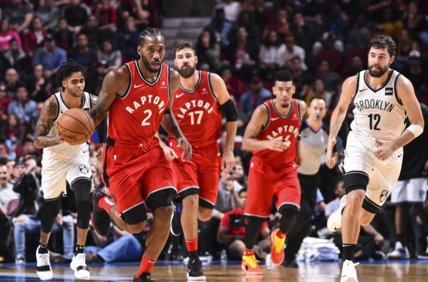 Toronto Raptors - Kawhi Leonard and Jonas Valanciunas (Photo by Minas Panagiotakis/Getty Images)