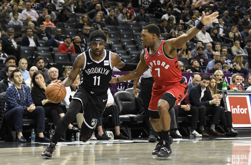 BROOKLYN, NY - OCTOBER 18: Kyrie Irving #11 of the Brooklyn Nets handles the ball during a pre-season game against the Toronto Raptors on October 18, 2019 at the Barclays Center in Brooklyn, New York. NOTE TO USER: User expressly acknowledges and agrees that, by downloading and or using this photograph, User is consenting to the terms and conditions of the Getty Images License Agreement. Mandatory Copyright Notice: Copyright 2019 NBAE (Photo by Brian Babineau/NBAE via Getty Images)