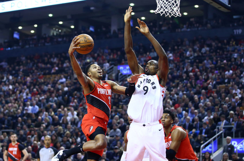 TORONTO, ON - JANUARY 07: Kent Bazemore #24 of the Portland Trail Blazers goes up for a shot as Serge Ibaka #9 of the Toronto Raptors defends during the first half of an NBA game at Scotiabank Arena on January 07, 2020 in Toronto, Canada. NOTE TO USER: User expressly acknowledges and agrees that, by downloading and or using this photograph, User is consenting to the terms and conditions of the Getty Images License Agreement. (Photo by Vaughn Ridley/Getty Images)