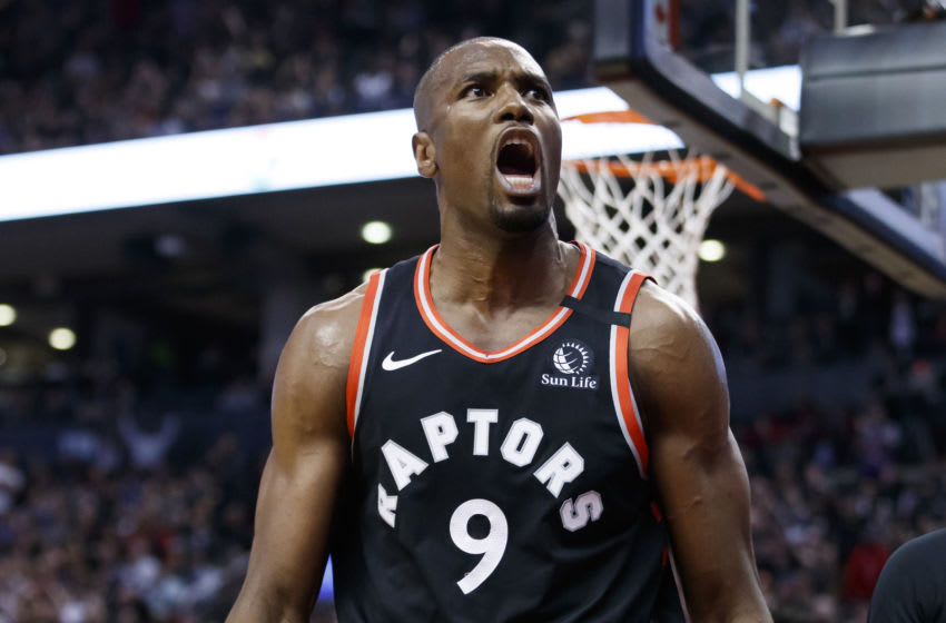 TORONTO, ON - JANUARY 22: Serge Ibaka #9 of the Toronto Raptors reacts after scoring a basket during second half their NBA game against the Philadelphia 76ers at Scotiabank Arena on January 22, 2020 in Toronto, Canada. NOTE TO USER: User expressly acknowledges and agrees that, by downloading and or using this photograph, User is consenting to the terms and conditions of the Getty Images License Agreement. (Photo by Cole Burston/Getty Images)