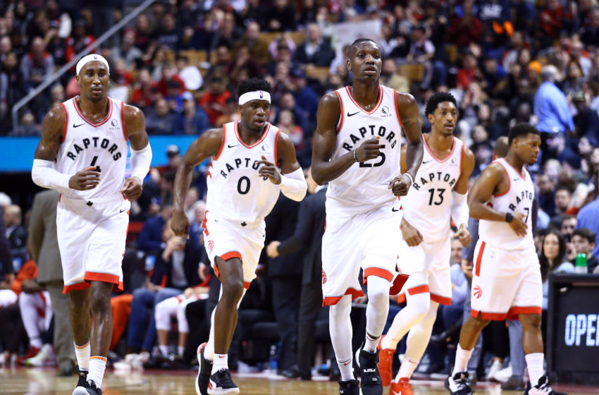 TORONTO, ON - DECEMBER 22: Rondae Hollis-Jefferson #4, Terence Davis II #0, Chris Boucher #25, Malcolm Miller #13 and Kyle Lowry #7 of the Toronto Raptors prepare for play to begin during the second half of an NBA game against the Dallas Mavericks at Scotiabank Arena on December 22, 2019 in Toronto, Canada. NOTE TO USER: User expressly acknowledges and agrees that, by downloading and or using this photograph, User is consenting to the terms and conditions of the Getty Images License Agreement. (Photo by Vaughn Ridley/Getty Images)