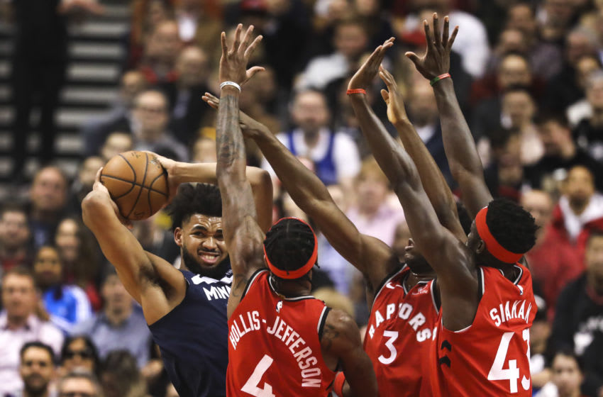 TORONTO, ON - February 10 In the first half, Minnesota Timberwolves center Karl-Anthony Towns (32) comes across some heavy Raptors defence. The Toronto Raptors took on the Minnesota Timberwolves at the Scotiabank arena in NBA basketball action. February 10, 2020 (Richard Lautens/Toronto Star via Getty Images)