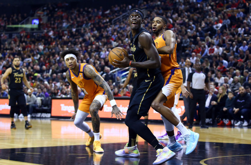 TORONTO, ON - FEBRUARY 21: Pascal Siakam #43 of the Toronto Raptors shoots the ball as Mikal Bridges #25 of the Phoenix Suns defends during the first half of an NBA game at Scotiabank Arena on February 21, 2020 in Toronto, Canada. NOTE TO USER: User expressly acknowledges and agrees that, by downloading and or using this photograph, User is consenting to the terms and conditions of the Getty Images License Agreement. (Photo by Vaughn Ridley/Getty Images)