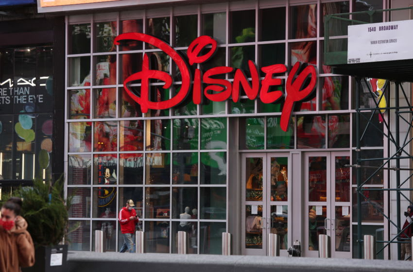 NEW YORK, NEW YORK - MAY 11: A person walks by a Disney store on May 11, 2020 in New York City. While some locations have begun reopening, New York City's stay-at-home order remains in place. COVID-19 has spread to most countries around the world, claiming over 286,000 lives with infections of over 4.2 million people. (Photo by Rob Kim/Getty Images)