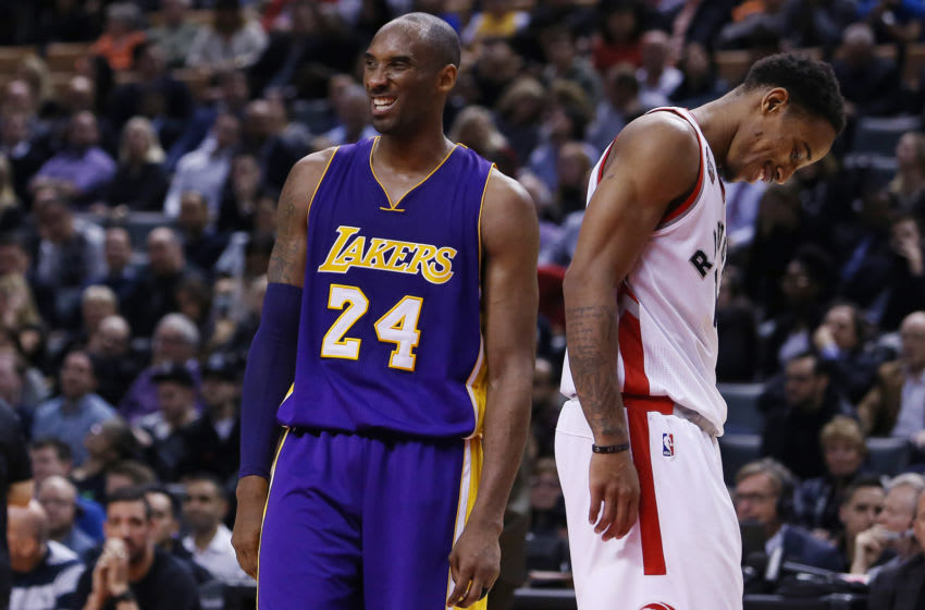 TORONTO, ON - DECEMBER 07: DeMar DeRozan #10 of the Toronto Raptors has a laugh with Kobe Bryant #24 of the Los Angeles Lakers during an NBA game at the Air Canada Centre on December 07, 2015 in Toronto, Ontario, Canada. NOTE TO USER: User expressly acknowledges and agrees that, by downloading and or using this photograph, User is consenting to the terms and conditions of the Getty Images License Agreement. (Photo by Vaughn Ridley/Getty Images)
