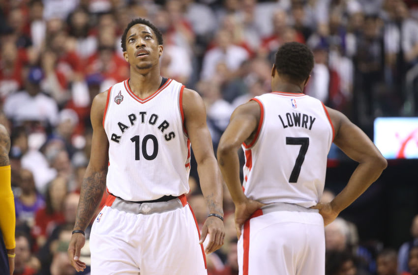 TORONTO, CANADA - APRIL 16: DeMar DeRozan #10 of the Toronto Raptors and Kyle Lowry #7 of the Toronto Raptors look on against the Indiana Pacers in Game One of the Eastern Conference Quarterfinals during the 2016 NBA Playoffs on April 16, 2016 at the Air Canada Centre in Toronto, Ontario, Canada. NOTE TO USER: User expressly acknowledges and agrees that, by downloading and or using this photograph, User is consenting to the terms and conditions of the Getty Images License Agreement. (Photo by Tom Szczerbowski/Getty Images)