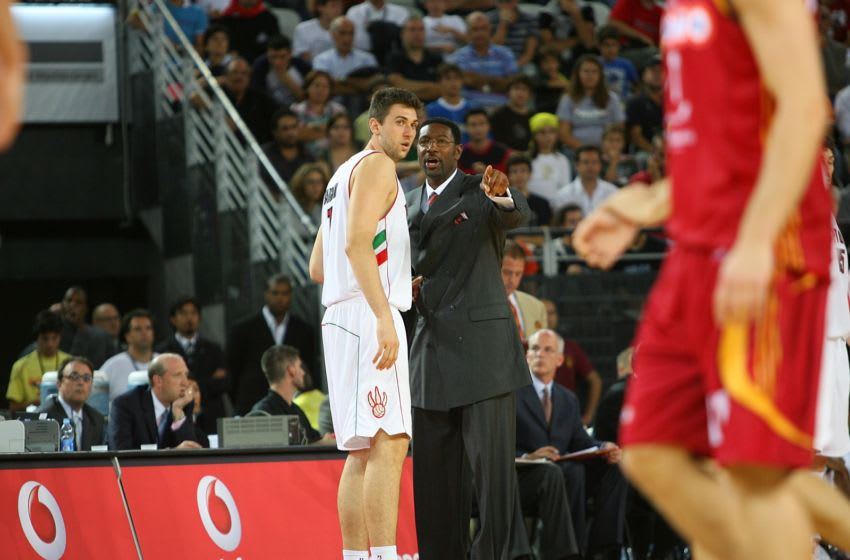 ROME, ITALY - OCTOBER 7: Andrea Bargnani #7 of the Toronto Raptors confers with head coach Sam Mitchell during a break in the action of a NBA preseason game against Lottomatica Virtus Roma as part of the 2007 NBA Europe Live Tour on October 7, 2007 at PalaLottomatica in Rome, Italy. NOTE TO USER: User expressly acknowledges and agrees that, by downloading and/or using this photograph, user is consenting to the terms and conditions of the Getty Images License Agreement. Mandatory Copyright Notice: Copyright 2007 NBAE (Photo by Jesse D. Garrabrant /NBAE via Getty Images)