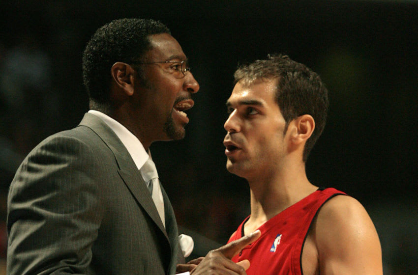 NBA Toronto Raptors' Spanish Jose Calderon (R) speaks with head coach Sam Mitchell (L) during their basket match against Real Madrid in Madrid, 11 October 2007. AFP PHOTO/ PIERRE-PHILIPPE MARCOU (Photo credit should read PIERRE-PHILIPPE MARCOU/AFP via Getty Images)