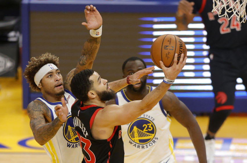 SAN FRANCISCO, CALIFORNIA - JANUARY 10: Fred VanVleet #23 of the Toronto Raptors goes up for a shot on Kelly Oubre Jr. #12 of the Golden State Warriors at Chase Center on January 10, 2021 in San Francisco, California. NOTE TO USER: User expressly acknowledges and agrees that, by downloading and or using this photograph, User is consenting to the terms and conditions of the Getty Images License Agreement. (Photo by Ezra Shaw/Getty Images)