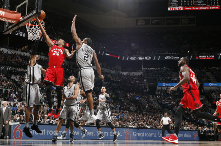 SAN ANTONIO, TX - APRIL 2: Norman Powell #24 of the Toronto Raptors goes for the layup against Kawhi Leonard #2 of the San Antonio Spurs during the game on April 2, 2016 at AT&T Center in San Antonio, Texas. NOTE TO USER: User expressly acknowledges and agrees that, by downloading and or using this Photograph, user is consenting to the terms and conditions of the Getty Images License Agreement. Mandatory Copyright Notice: Copyright 2016 NBAE (Photo by Chris Covatta/NBAE via Getty Images)