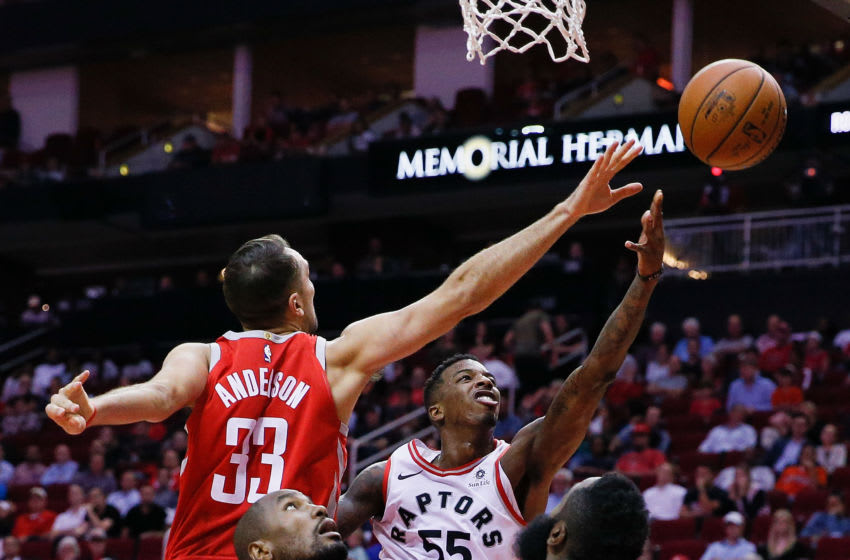 Toronto Raptors Delon Wright and Houston Rockets Ryan Anderson - (Photo by Bob Levey/Getty Images)