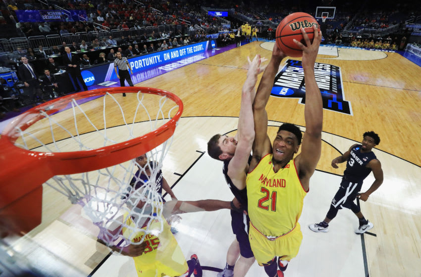 ORLANDO, FL - MARCH 16: Justin Jackson #21 of the Maryland Terrapins dunks the ball against Sean O'Mara #54 of the Xavier Musketeers in the first half during the first round of the 2017 NCAA Men's Basketball Tournament at Amway Center on March 16, 2017 in Orlando, Florida. (Photo by Rob Carr/Getty Images)
