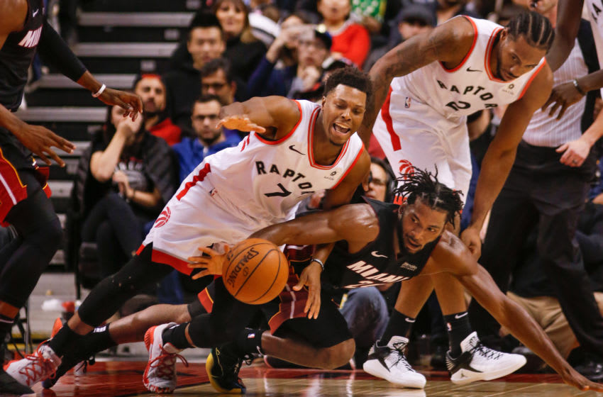 TORONTO, ON - NOVEMBER 25: Toronto Raptors guard Kyle Lowry (7) and Miami Heat forward Justise Winslow (20) scramble after the loose ball. Toronto Raptors vs New Orleans Pelicans in 2nd half action of NBA regular season play at Air Canada Centre. Raptors won 125-115. Toronto Star/Rick Madonik (Rick Madonik/Toronto Star via Getty Images)