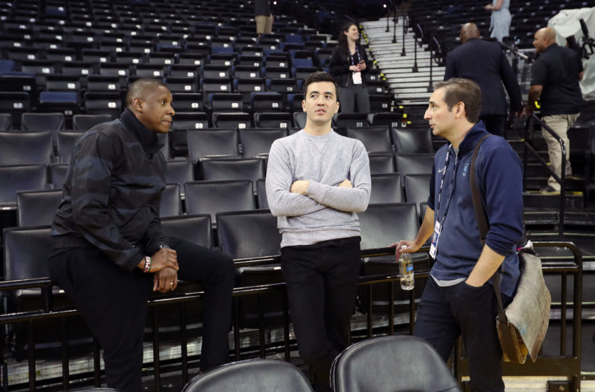 OAKLAND, CA - JUNE 6: President of Basketball Operations Masai Ujiri and General Manager Bobby Webster of the Toronto Raptors speak to ESPN writer Zach Lowe during practice as part of the 2019 NBA Finals on June 6, 2019 at ORACLE Arena in Oakland, California. NOTE TO USER: User expressly acknowledges and agrees that, by downloading and/or using this photograph, user is consenting to the terms and conditions of the Getty Images License Agreement. Mandatory Copyright Notice: Copyright 2019 NBAE (Photo by Joe Murphy/NBAE via Getty Images)