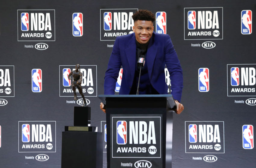 SANTA MONICA, CA - JUNE 24: Giannis Antetokounmpo #34 of the Milwaukee Bucks peaks with the media during a press conference after the 2019 NBA Awards Show at the Barker Hangar on June 24, 2019 in Santa Monica, California. NOTE TO USER: User expressly acknowledges and agrees that, by downloading and/or using this Photograph, user is consenting to the terms and conditions of the Getty Images License Agreement. Mandatory Copyright Notice: Copyright 2019 NBAE (Photo by Will Navarro/NBAE via Getty Images)