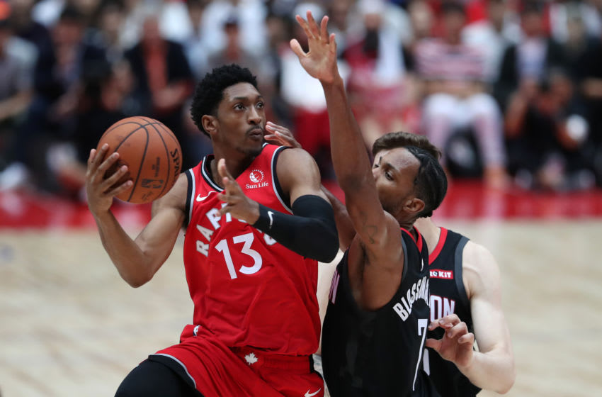 SAITAMA, JAPAN - OCTOBER 08: Malcolm Miller #13 of Toronto Raptors drives to the basket against Jaron Blossomgame #7 of Houston Rockets during the preseason game between Houston Rockets and Toronto Raptors at Saitama Super Arena on October 08, 2019 in Saitama, Japan. NOTE TO USER: User expressly acknowledges and agrees that, by downloading and/or using this photograph, user is consenting to the terms and conditions of the Getty Images License Agreement. (Photo by Takashi Aoyama/Getty Images)