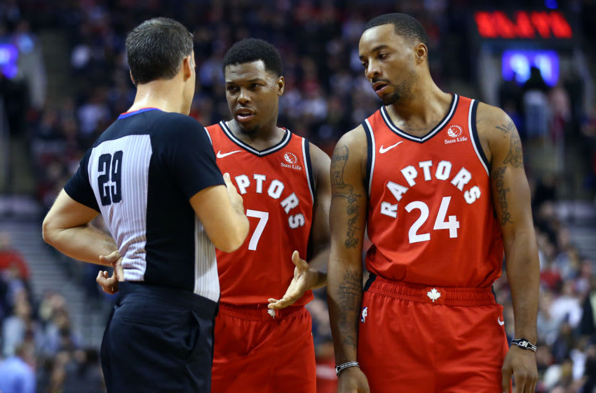 TORONTO, ON - DECEMBER 05: Kyle Lowry #7 and Norman Powell #24 of the Toronto Raptors talk to an official during the first half of an NBA game against the Houston Rockets at Scotiabank Arena on December 05, 2019 in Toronto, Canada. NOTE TO USER: User expressly acknowledges and agrees that, by downloading and or using this photograph, User is consenting to the terms and conditions of the Getty Images License Agreement. (Photo by Vaughn Ridley/Getty Images)