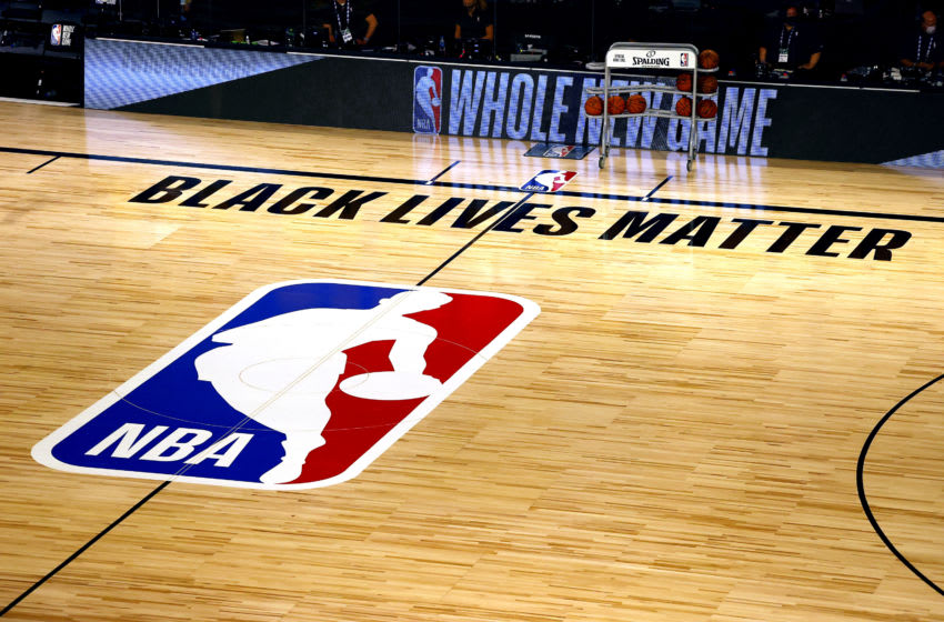 LAKE BUENA VISTA, FLORIDA - AUGUST 01: An overview of the Toronto Raptors court with NBA logo and Black Lives Matter (Photo by Kevin C. Cox/Getty Images)