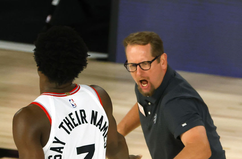 LAKE BUENA VISTA, FLORIDA - AUGUST 19: Nick Nurse of the Toronto Raptors celebrates with OG Anunob (Photo by Kevin C. Cox/Getty Images)