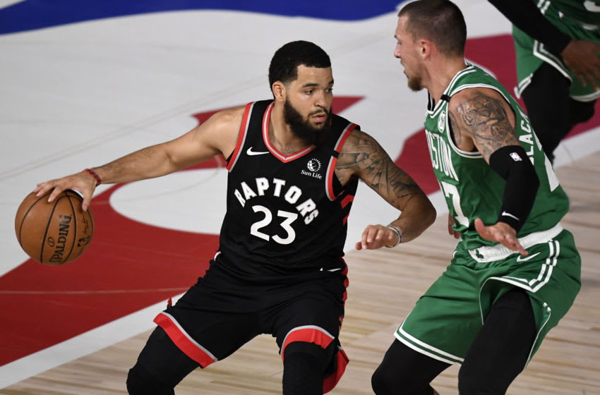 LAKE BUENA VISTA, FLORIDA - SEPTEMBER 03: Fred VanVleet #23 of the Toronto Raptors drives the ball against Daniel Theis #27 of the Boston Celtics during the first quarter in Game Three of the Eastern Conference Second Round during the 2020 NBA Playoffs at the Field House at the ESPN Wide World Of Sports Complex on September 03, 2020 in Lake Buena Vista, Florida. NOTE TO USER: User expressly acknowledges and agrees that, by downloading and or using this photograph, User is consenting to the terms and conditions of the Getty Images License Agreement. (Photo by Douglas P. DeFelice/Getty Images)