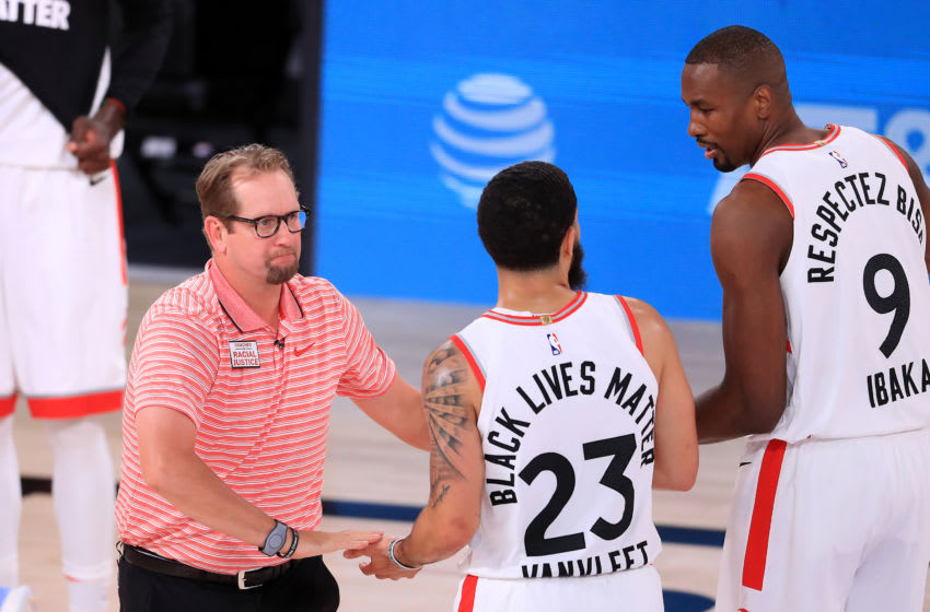 LAKE BUENA VISTA, FLORIDA - SEPTEMBER 11: Nick Nurse of the Toronto Raptors reacts with Serge Ibaka #9 of the Toronto Raptors and Fred VanVleet #23 of the Toronto Raptors during the first quarter in Game Seven of the Eastern Conference Second Round during the 2020 NBA Playoffs at AdventHealth Arena at the ESPN Wide World Of Sports Complex on September 11, 2020 in Lake Buena Vista, Florida. NOTE TO USER: User expressly acknowledges and agrees that, by downloading and or using this photograph, User is consenting to the terms and conditions of the Getty Images License Agreement. (Photo by Michael Reaves/Getty Images)
