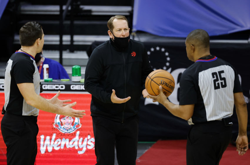 PHILADELPHIA, PENNSYLVANIA - DECEMBER 29: Head coach Nick Nurse speaks to referee Tony Brothers #25 during the fourth quarter at Wells Fargo Center on December 29, 2020 in Philadelphia, Pennsylvania. NOTE TO USER: User expressly acknowledges and agrees that, by downloading and or using this photograph, User is consenting to the terms and conditions of the Getty Images License Agreement. (Photo by Tim Nwachukwu/Getty Images)