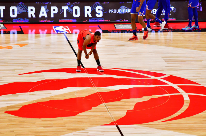 TAMPA, FLORIDA - DECEMBER 31: Kyle Lowry #7 of the Toronto Raptors stretches on center court before tip-off against the New York Knicks at Amalie Arena on December 31, 2020 in Tampa, Florida. NOTE TO USER: User expressly acknowledges and agrees that, by downloading and or using this photograph, User is consenting to the terms and conditions of the Getty Images License Agreement. (Photo by Julio Aguilar/Getty Images)