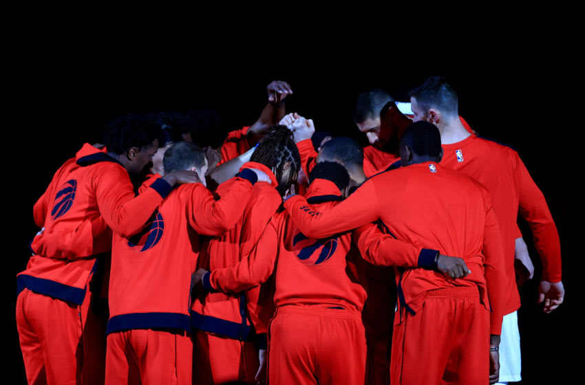 TAMPA, FLORIDA - JANUARY 04: The Toronto Raptors huddle (Photo by Mike Ehrmann/Getty Images)