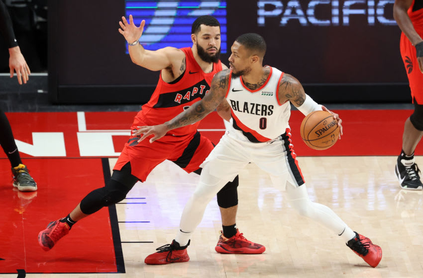 PORTLAND, OREGON - JANUARY 11: Damian Lillard #0 of the Portland Trail Blazers controls the ball against Fred VanVleet #23 of the Toronto Raptors in the second quarter at Moda Center on January 11, 2021 in Portland, Oregon. NOTE TO USER: User expressly acknowledges and agrees that, by downloading and or using this photograph, User is consenting to the terms and conditions of the Getty Images License Agreement. (Photo by Abbie Parr/Getty Images)