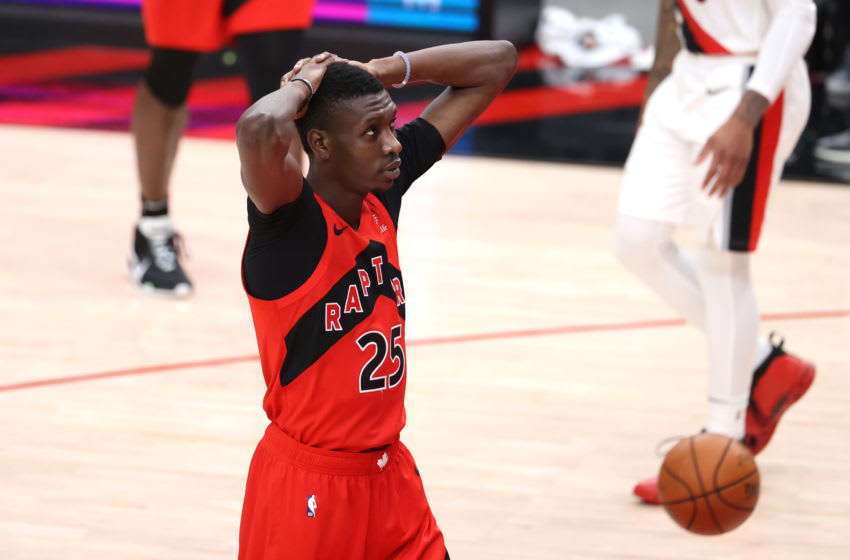 PORTLAND, OREGON - JANUARY 11: Chris Boucher #25 of the Toronto Raptors reacts in the fourth quarter against the Portland Trail Blazers at Moda Center on January 11, 2021 in Portland, Oregon. NOTE TO USER: User expressly acknowledges and agrees that, by downloading and or using this photograph, User is consenting to the terms and conditions of the Getty Images License Agreement. (Photo by Abbie Parr/Getty Images)