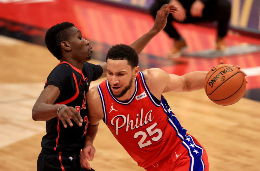 TAMPA, FLORIDA - FEBRUARY 21: Ben Simmons #25 of the Philadelphia 76ers drives on Chris Boucher #25 of the Toronto Raptors (Mike Ehrmann/Getty Images
