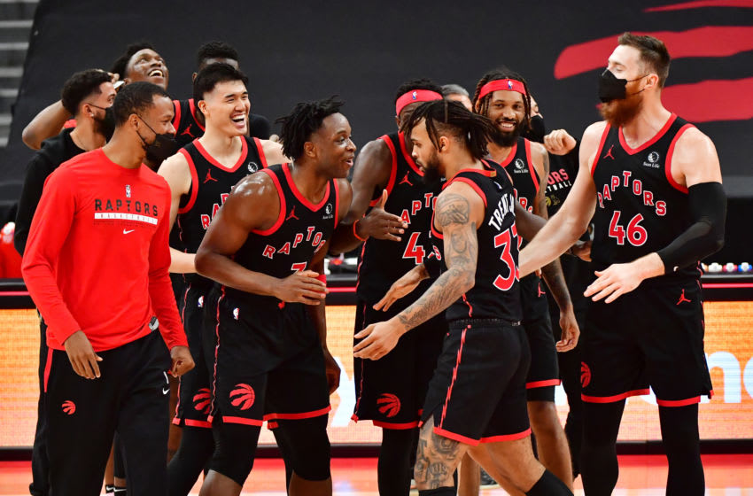 TAMPA, FLORIDA - APRIL 05: Gary Trent Jr. #33 of the Toronto Raptors celebrates with teammates (Photo by Julio Aguilar/Getty Images)