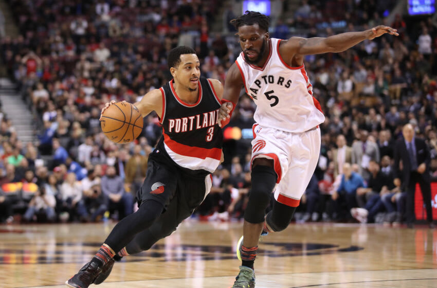 TORONTO, ON - FEBRUARY 26: C.J. McCollum #3 of the Portland Trail Blazers goes to the basket against DeMarre Carroll #5 of the Toronto Raptors (Photo by Tom Szczerbowski/Getty Images)
