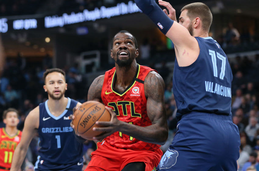 Mar 7, 2020; Memphis, Tennessee, USA; Atlanta Hawks center Dewayne Dedmon (14) drives against Memphis Grizzlies center Jonas Valanciunas (17) as Memphis forward Kyle Anderson (1) looks on at FedExForum. Mandatory Credit: Nelson Chenault-USA TODAY Sports