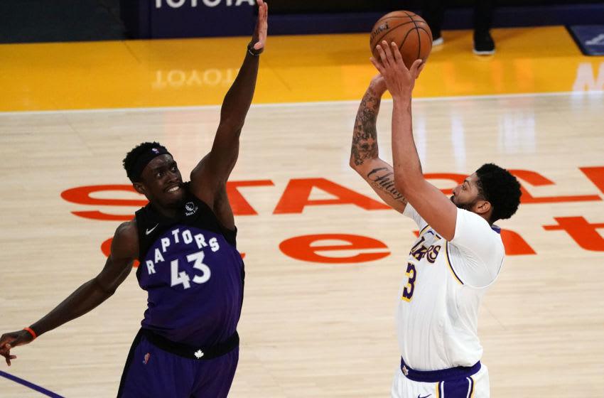May 2, 2021; Los Angeles, California, USA; Los Angeles Lakers forward Anthony Davis (3) shoots against Toronto Raptors forward Pascal Siakam (43) Mandatory Credit: Gary A. Vasquez-USA TODAY Sports