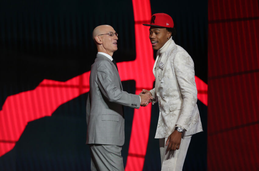 Jul 29, 2021; Brooklyn, New York, USA; Scottie Barnes (Florida State) poses with NBA commissioner Adam Silver after being selected as the number four overall pick by the Toronto Raptors Mandatory Credit: Brad Penner-USA TODAY Sports