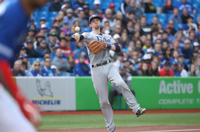 TORONTO, ON - SEPTEMBER 22: Matt Duffy #5 of the Tampa Bay Rays makes the play and throws out the baserunner in the first inning during MLB game action against the Toronto Blue Jays at Rogers Centre on September 22, 2018 in Toronto, Canada. (Photo by Tom Szczerbowski/Getty Images)