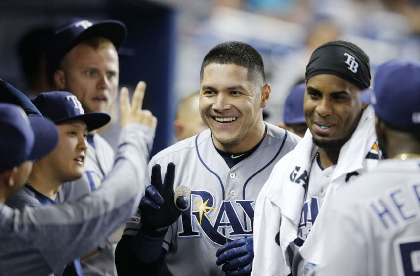 MIAMI, FLORIDA - MAY 14: Avisail Garcia #24 of the Tampa Bay Rays celebrates with teammates after hitting a solo home run in the second inning against the Miami Marlins at Marlins Park on May 14, 2019 in Miami, Florida. (Photo by Michael Reaves/Getty Images)