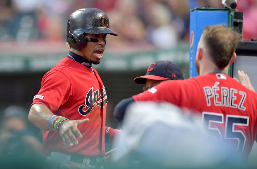 CLEVELAND, OHIO - SEPTEMBER 13: Francisco Lindor #12 of the Cleveland Indians celebrates with Roberto Perez #55 celebrates after scoring during the first inning against the Minnesota Twins at Progressive Field on September 13, 2019 in Cleveland, Ohio. (Photo by Jason Miller/Getty Images)