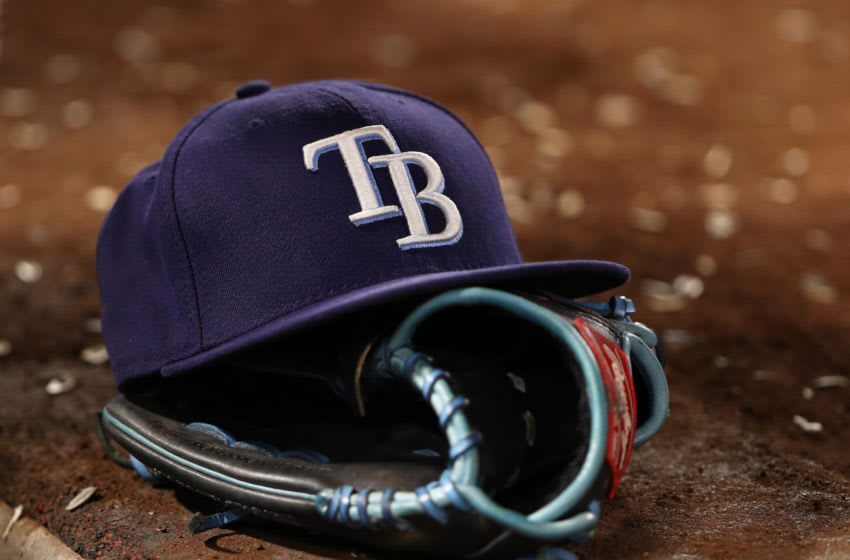 ANAHEIM, CALIFORNIA - SEPTEMBER 14: A detailed view of a Tampa Bay Rays hat and catching glove is seen on a dugout step during the sixth inning of the MLB game between the Tampa Bay Rays and the Los Angeles Angels at Angel Stadium of Anaheim on September 14, 2019 in Anaheim, California. The Rays defeated the Angels 3-1. (Photo by Victor Decolongon/Getty Images)