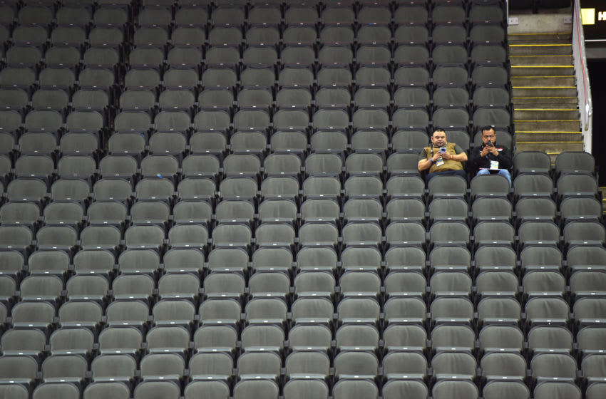KANSAS CITY, MISSOURI - MARCH 12: Two journalists sit in an empty Sprint Center after it was announced that the Big 12 basketball tournament had been cancelled due to growing concerns with the Coronavirus (COVID-19) outbreak on March 12, 2020 in Kansas City, Missouri. (Photo by Ed Zurga/Getty Images)