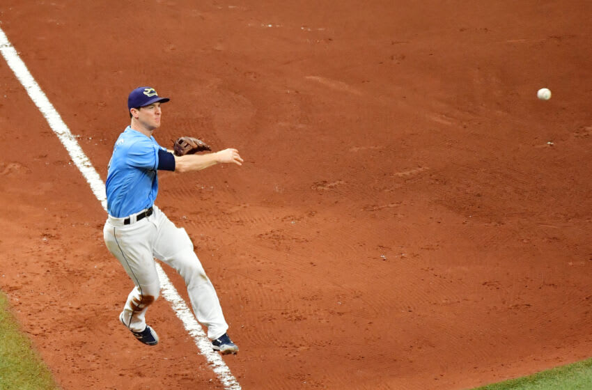 ST PETERSBURG, FLORIDA - AUGUST 22: Joey Wendle #18 of the Tampa Bay Rays throws during a game against the Chicago White Sox at Tropicana Field on August 22, 2021 in St Petersburg, Florida. (Photo by Julio Aguilar/Getty Images)