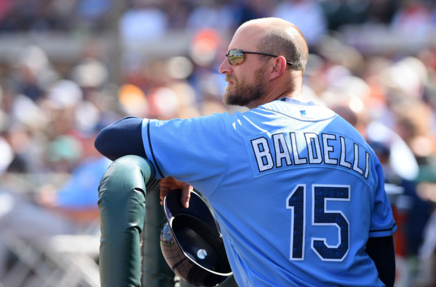 LAKELAND, FL - MARCH 08: First base coach Rocco Baldelli #15 of the Tampa Bay Rays looks on from the dugout during the Spring Training game against the Detroit Tigers at Joker Marchant Stadium on March 8, 2016 in Lakeland, Florida. The Tigers defeated the Rays 6-5. (Photo by Mark Cunningham/MLB Photos via Getty Images)