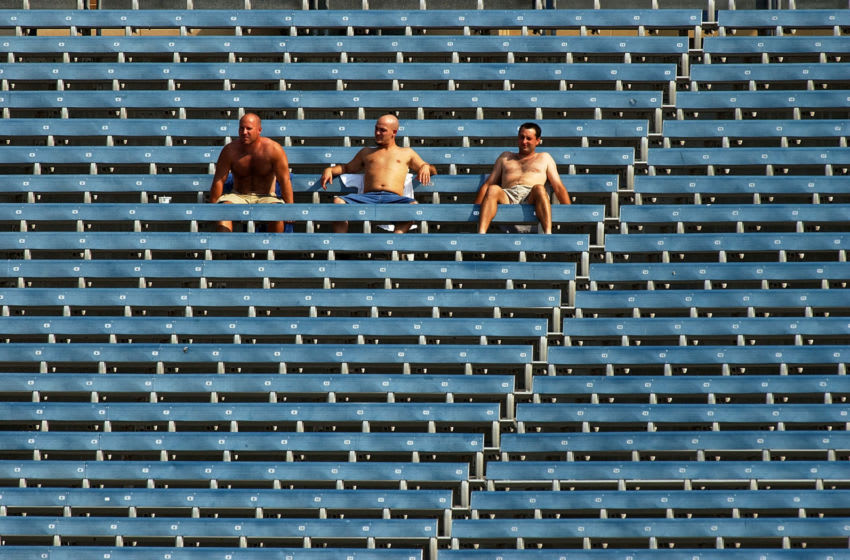 CHICAGO - SEPTEMBER 13: Three of about 4,000 fans watch as the Florida Marlins take on the Montreal Expos in a game on September 13, 2004 at U.S. Cellular Field in Chicago, Illinois. The game was moved to Chicago to avoid Hurricane Ivan. The Marlins defeated the Expos 6-3. (Photo by Jonathan Daniel/Getty Images)