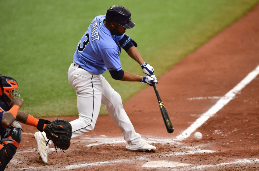 ST PETERSBURG, FLORIDA - MAY 02: Manuel Margot #13 of the Tampa Bay Rays hits an RBI single during the seventh inning against the Houston Astros at Tropicana Field on May 02, 2021 in St Petersburg, Florida. (Photo by Douglas P. DeFelice/Getty Images)
