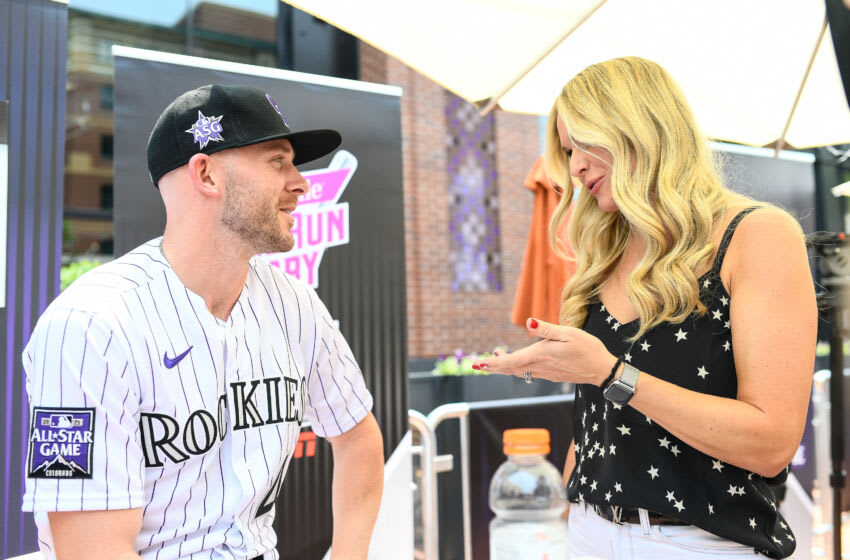 DENVER, CO - JULY 12: Trevor Story #27 of the Colorado Rockies talks to MLB Network reporter Heidi Watney during the Gatorade All-Star Workout Day outside of Coors Field on July 12, 2021 in Denver, Colorado. (Photo by Dustin Bradford/Getty Images)