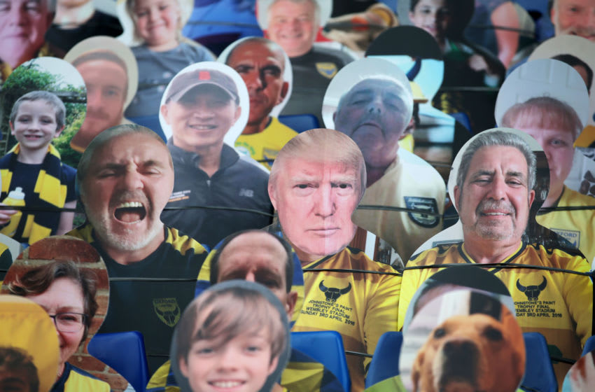 OXFORD, ENGLAND - JULY 06: A cardboard cut-out of Donald Trump is found amongst cut-outs of Oxford Utd fans in the stands ahead of the Sky Bet League One Play Off Semi-final 2nd Leg match between Oxford United and Portsmouth FC at Kassam Stadium on July 06, 2020 in Oxford, England. Football Stadiums around Europe remain empty due to the Coronavirus Pandemic as Government social distancing laws prohibit fans inside venues resulting in all fixtures being played behind closed doors. (Photo by Robin Jones/Getty Images)